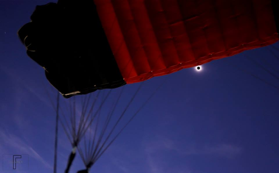 View from under parachute during solar eclipse at totality